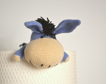 Amigurumi donkey, plush animal toy for children.