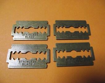 1 large charm / pendant bronze razor blade. 4.4 cm long.