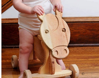 Toddler ride on toy solid wood. Horse.©