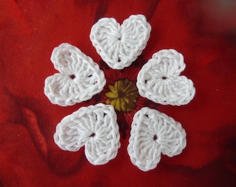 5 small white crochet hearts
