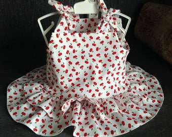 Baby dress with ruffles and little knots