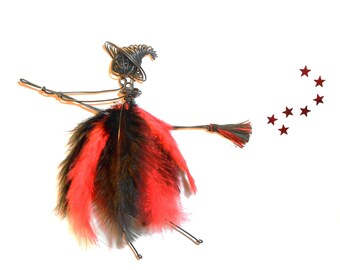 Witch wire red and black feathers