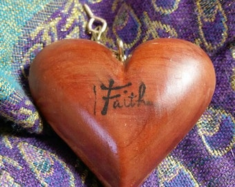 You've Captured My Heart- wood carved heart in a Cage.