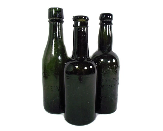 English Antique Set of Three Green Glass Beer Bottles