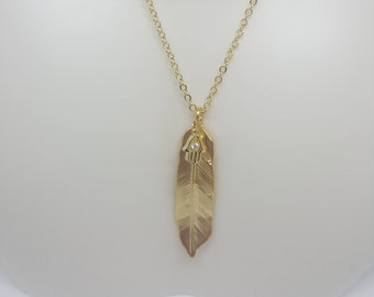 Gold feather w/ hand and heart charm necklace
