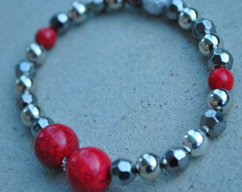 Handmade bracelet,red and silver beads with a white/silver accent one