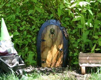 A Fairy door / Gnome door that OPENS. 12 inch rounded Gnome / Fairy door with lion knock.