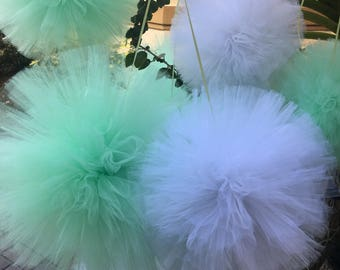 This listing is for a set of 16 tulle poms baby shower weddings and more..