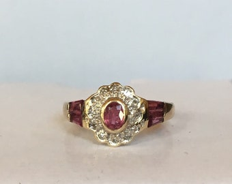 Antique Oval and tapered baguette Ruby and Diamond scalloped halo Gold ring one of a kind