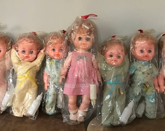 Vintage Lot of 7 Collette Baby Dolls with Bottles Original Wrapping Sealed Unused