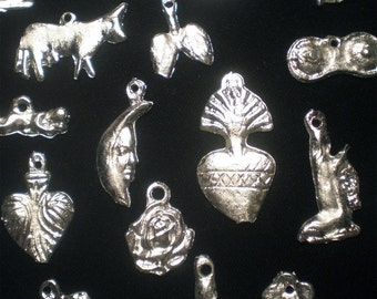 50 milagro charms. Mexican milagros for altars, jewelry, mixed media art, and much more.