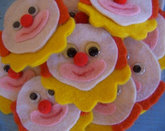 fifteen vintage felt clown heads