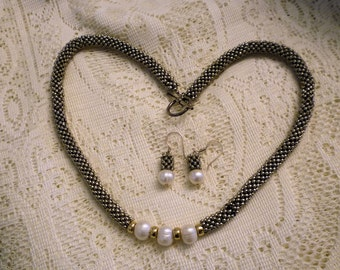 Silver Metal Beads Stacked Upon each other with Fresh Water Pearl and Gold Accents