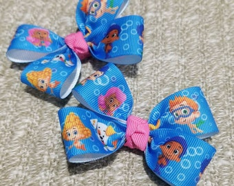 Set of 2 bubble guppies hair bow on a non slip alligator clip