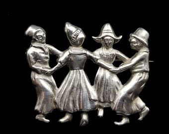 LANG DUTCH DANCERS brooch, vintage sterling silver pin by Lang, 4 folk dancers in traditional costumes of Holland, 1940s