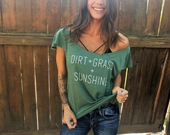 Dirt + Grass + Sunshine. Off the Shoulder Flutter Sleeve Flowy Muscle Tee. Made in the USA. Off the Shoulder Lounge Tee. Country Shirt.