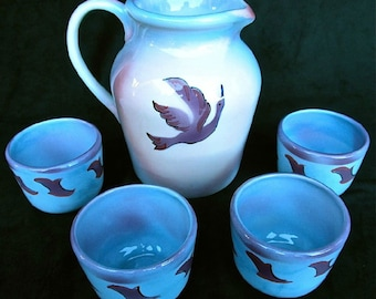 Pitcher and 4 cups set with hand cut original bird stencil in purple and blue. Airbrushed and handpainted lead free glazes.