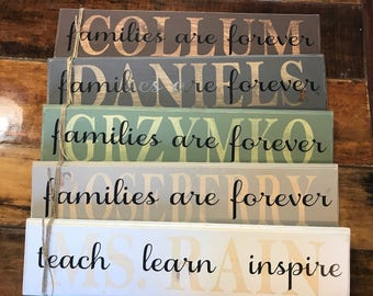 "Name signs ""families are forever"""