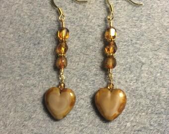 Opaque caramel Czech glass heart bead dangle earrings adorned with caramel Czech glass beads.