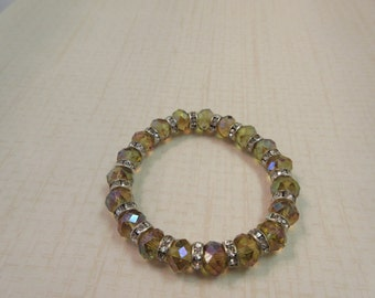 Gorgeous Gold Crystal rondelle beaded bracelet with silver rhinestone spacers.