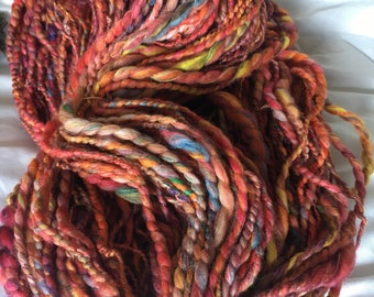 handspun art yarn merino pinks orange