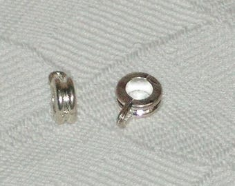 2 pretty striated silver bails
