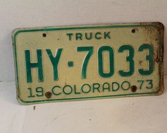 Vintage 1973 Colorado truck license plate HY-7033 green white