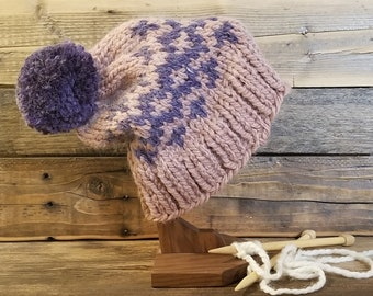Adult pink and amethyst hand knit fair isle pom hat