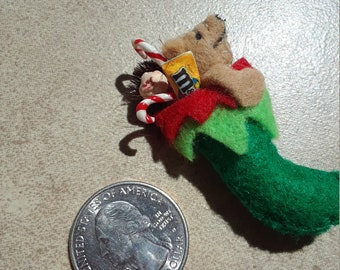 An adorable Christmas stocking filled with candy and teddy bear and doll 1:12 size