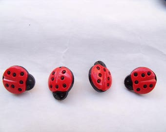 Red Ladybug with six three dots buttons each wings
