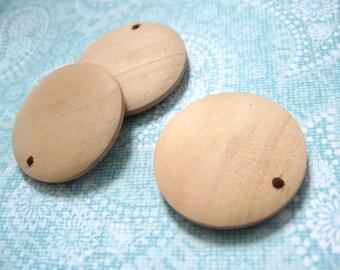 3 Pendentifs de bois naturel en forme de cercle