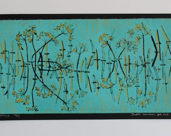 Lino section water side. A reflective landscape of flowers and grasses that protrude above the water.