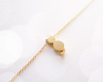 Delicate gold bracelet with cat