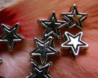 Set of 2 beads silver metal star
