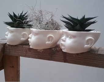 doll head planter - resin