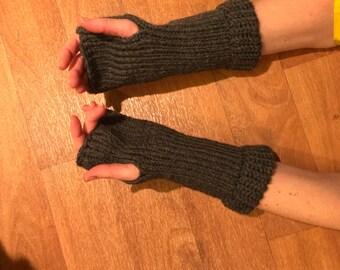 Grey knitted fingerless gloves.