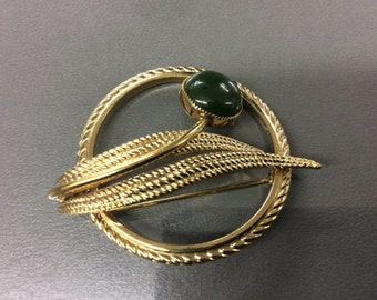 Gold filled pin with green stone