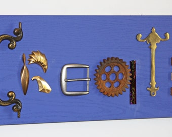 """Sign spells """"Create"""" - Wall Plaque Repurposed Art - Door Handles, Gears, Glass, Tile, Belt Buckle"""