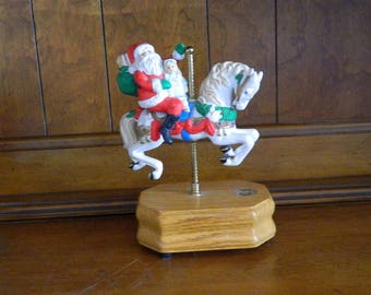 "Westland Santa on Carousel Horse Music Box - Plays ""Santa Claus Is Coming To Town"""
