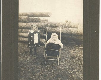 Antique Large Cabinet Photograph  Children in Stroller in Fron of Wood Pile