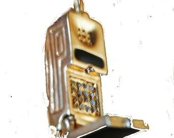 Vintage 80s gold tone metal telephone brooch  accented with a black enamel and clear rhinestones.