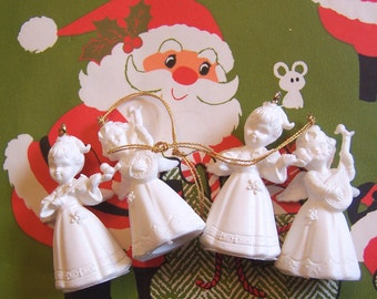 four tiny white angel ornaments