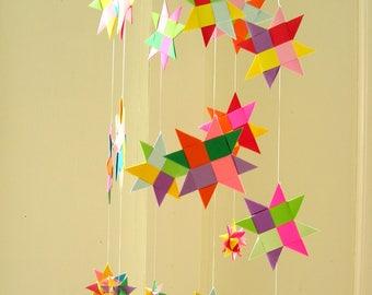 Mobile of multicolored stars.