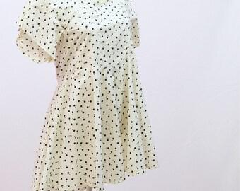 SALE 1980s handmade dipped hem polka dot dress in white with black dots