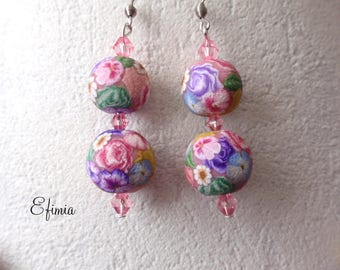 Earrings consisted of two round beads in a floral, pastel colors