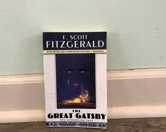 "F. Scott Fitzgerald ""The Great Gatsby"" paperback novel"
