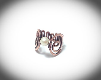 Wire wrapped copper ring with pearl and scroll band