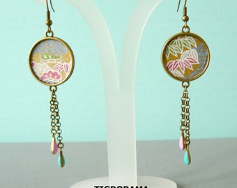 twin paper cabochon earrings Japanese flowers on blue background and outstanding