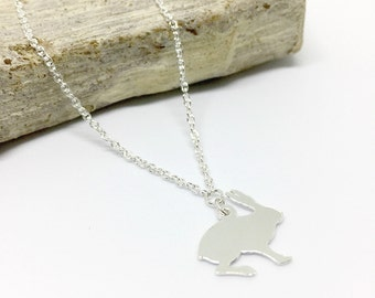 Hare silhouette charm necklace on fine sterling silver chain.