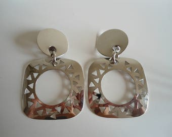 Stylish 80s silver vintage earrings.